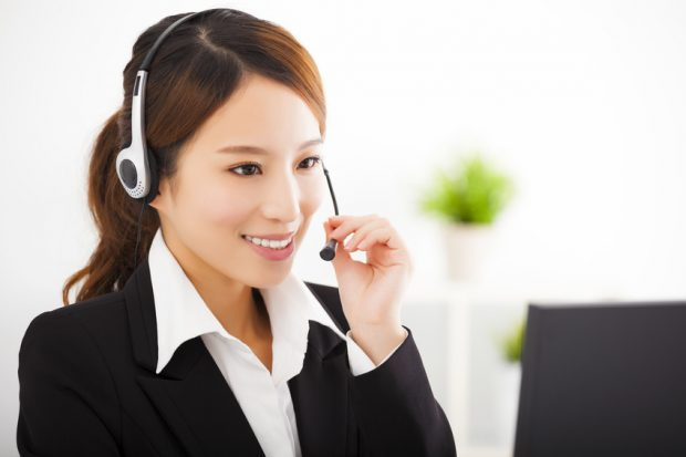 young beautiful businesswoman with headset in office